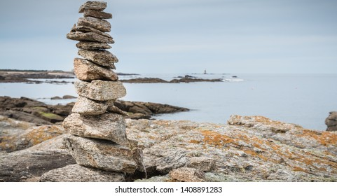 cairn on a hiking trail on the island of Yeu, France