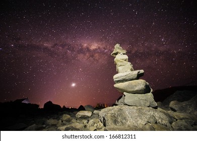 Cairn placed on a rock under the Milky Way Stars in New Zealand