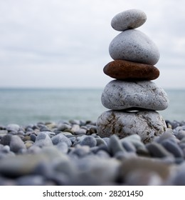 cairn of stone at the beach of the sea
