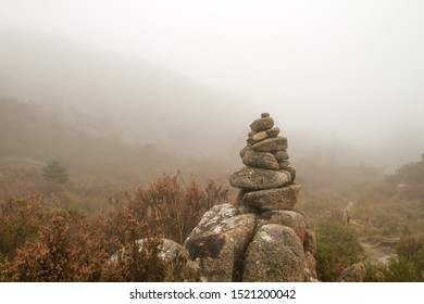 Cairn or stones pile marking a mountain trail