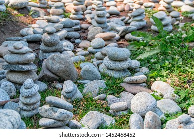 Cairn stones piled in hills. Pyramids of stones, cairn stone sculpture stone, nature land.