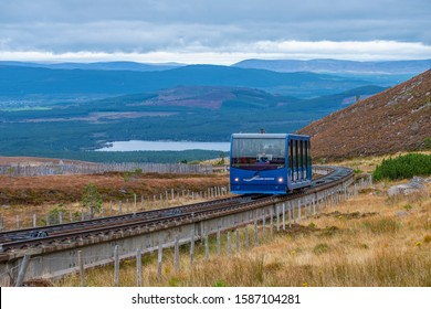 Cairngorm Mountain, Scottish Highlands, UK - October 10, 2019: blue tramcar taking tourist up to the famous Cairngorm Mountain