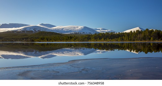Cairngorm national park and reflections in loch Morlich Scotland