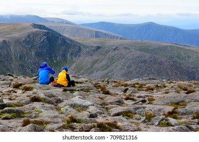 CAIRNGORMS, SCOTLAND - AUG. 21, 2017: A couple admiring the view at the Cairn Gorm Mountain summit in the Cairngorm National Park, Scotland