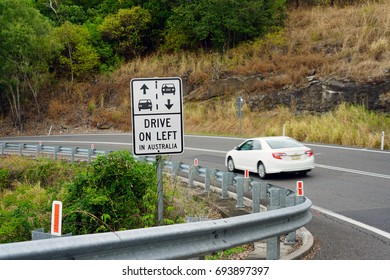 CAIRNS, AUSTRALIA -4 AUG 2017- Road sign warning drivers to Drive on Left in Australia.