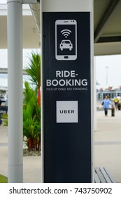 CAIRNS, AUSTRALIA -4 AUG 2017- Sign for Uber ride booking pick-up at the Cairns Airport (CNS) in Far North Queensland, Australia.