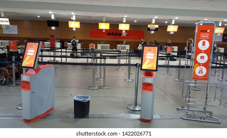 CAIRNS, AUSTRALIA - OCTOBER 16, 2018: Jetstar check-in counter and self service check-in kiosk in Cairns Domestic Airport.