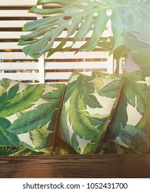 Cairns Queensland Australia March12, 2018; Tropical Courtyard with white plantation shutter background and tropical banana leaf outdoor cushions