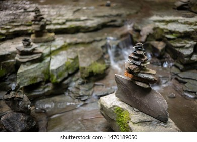 Cairns, or rock piles, made by hikers in a creek at the IBM Glen, a local park with hiking trails and waterfalls  in New York State.