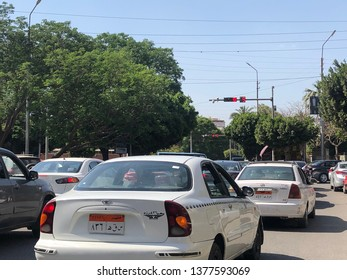 Cairo - April, 21 2019: Taxi cars in Heliopolis streets in the Egyptian capital