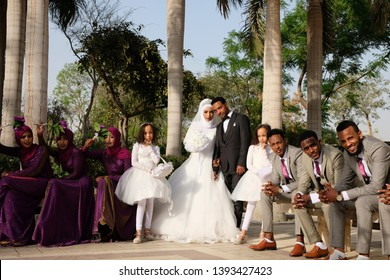 Cairo - April, 26 2019: Bridesmaids and Groomsmen with the bride and the groom at a wedding photo session of Sudanese people in Al-Azhar Park in old Cairo.