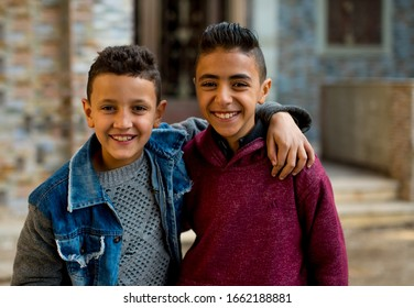 Cairo, Egypt, 01.02.2020 Two Young Egyptian kids smile in the street. Egyptian kids. Egyptian boys. Arabic boys.