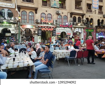 Cairo, Egypt. 07 May 2019. People are eating iftar to break the fast during Ramadan in Khan Khalili Market. Khan Khalili is the most popular place for Ramadan activities in Cairo.