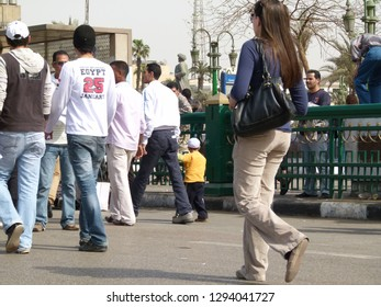 """Cairo - Egypt - 1 april 2011 -A group of demonstrators walking towards Tahrir Square, a demonstrator wearing a jacket with the words """"Egypt, January 25"""""""