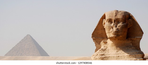 CAIRO EGYPT 11 22 10: Great Sphinx of Giza statue of a reclining sphinx, a mythical creature with the body of a lion and the head of a human and Great Pyramid of Giza or the Pyramid of Khufu or Cheops
