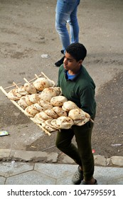 CAIRO, EGYPT - 2 JANUARY 2018: A boy selling bread in the streets of Cairo. Egypt's informal economy of unlicensed & unregistered capital & property, constitutes 34 percent of GDP. Editorial