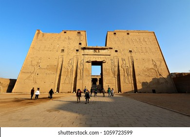 CAIRO, EGYPT - 2 JANUARY 2018: Tourists visit the ancient ruins of Edfu Temple. Egyptian tourism has dropped from 25 million visitors in 2010 to 5 million in 2017 following the Arab Spring. Editorial