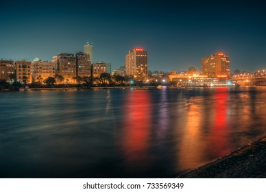 Cairo, Egypt - 2011 ( Cairo Skyline at night showing the famous two buildings of Marriott Hotel and maxim boat restaurant )