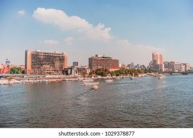 Cairo, Egypt - 2011 - Cairo skyline showing the Nile Ritz Carlton, The Arab League, Intercontinental Cairo Semiramis & the National Democratic Party Building after the fire of the 2011 revolution.