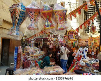 Cairo, Egypt. 26 March 2019. Shop in Bab Zuweila selling colorful decorations for Ramadan month such as fanoos (lantern), banner and traditional fabrics.
