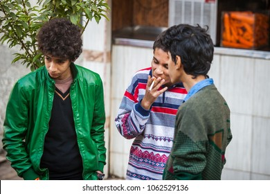 Cairo, Egypt - 29/12/2014: Kids smoking on the street