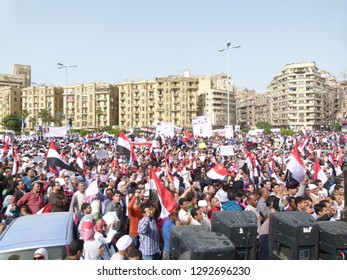Cairo - Egypt - 4 april 2011 - Egyptian revolution - Many crowds carrying Egyptian flags in Tahrir Square