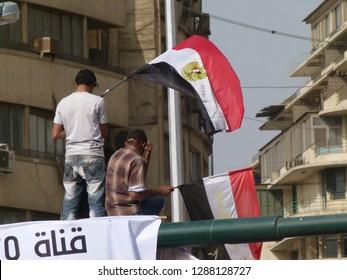 Cairo - Egypt - 4 February 2011 - Egyptian revolution - men carrying Egyptian flag in Tahrir Square
