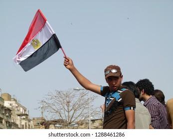 Cairo - Egypt - 4 February 2011 - Egyptian revolution - man carrying Egyptian flag in Tahrir Square