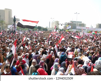 Cairo - Egypt - 4 February 2011 - Egyptian revolution - Many crowds carrying Egyptian flags in Tahrir Square