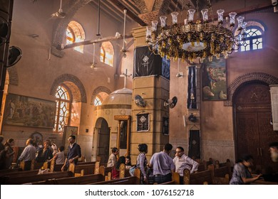 CAIRO, EGYPT - April 2018: Coptic Orthodox Church at Old Cairo area. People inside the church at evening prayer, Cairo, Egypt