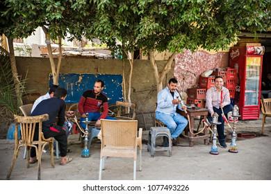CAIRO, EGYPT - April 2018: Egyptian men smoking shisha (hookah) at street tea shop at Old Cairo district, Egypt