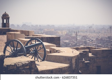 cairo, egypt, april 22, 2017: cityscape background from cairo citadel with view of cannon, ramadan concept background