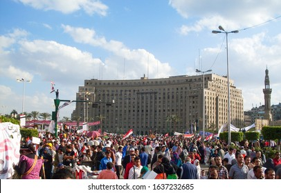 CAIRO, EGYPT - April 8 2011- Egyptian Revolution -Thousands of protesters flocked to Cairo's Tahrir Square, Egypt, People were dead and injured because of tear gas, rubber bullets of riot police