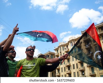 CAIRO, EGYPT - April 8 2011- The Arab Spring Revolution -  protesters Support Libyan protests against the regime of Muammar Gaddafi - Tahrir Square, Egypt, Libya flag