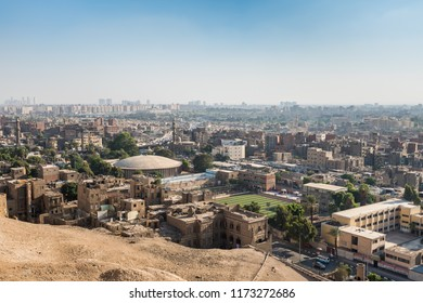 Cairo, Egypt, August 12th, 2018: Aerial view of Cairo of crowded buildings with dust sky from Saladin Citadel of Cairo