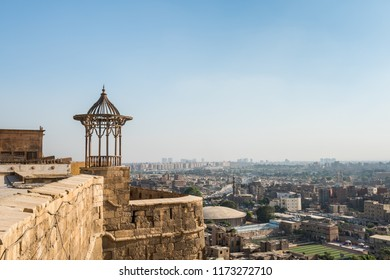 Cairo, Egypt, August 12th, 2018: Pavilion of Saladin Citadel of Cairo and Aerial view of Cairo of crowded buildings with dusty sky