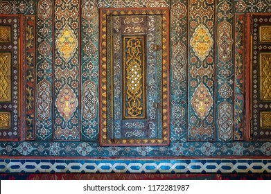 Cairo, Egypt - August 26 2018: Floral ornaments of wooden embedded cupboards painted with colored geometrical patterns, Syrian hall of historic Manial palace of Prince Mohammed Ali