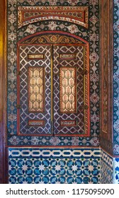 Cairo, Egypt - August 26 2018: Embedded vintage cupboard painted with colorful floral patterns at Syrian hall of historic Manial palace of Prince Mohammed Ali