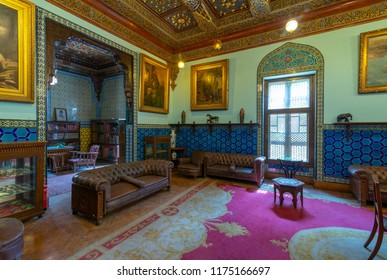 Cairo, Egypt - August 26 2018: Manial Palace of Prince Mohammed Ali. Living room at the residence building with Turkish floral blue pattern ceramic tiles, vintage furniture, European style paintings