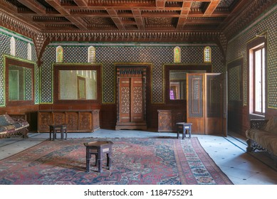 Cairo, Egypt - August 26 2018: Manial Palace of Prince Mohammed Ali. Moroccan hall at the ceremonies building with blue Turkish floral pattern ceramic tiles, vintage furniture, and framed mirrors