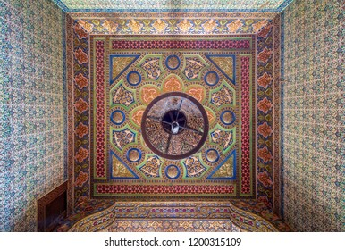 Cairo, Egypt - August 26 2018: Royal era colorful engraved wooden ceiling with floral pattern decorations at historic Manial palace of Prince Mohammed Ali