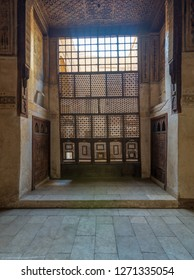 Cairo, Egypt - December 16 2018:  Interleaved wooden window (Mashrabiya), wooden embedded cupboards, and wooden decorated ceiling at ottoman historic Beit El Set Waseela building (Waseela Hanem House)