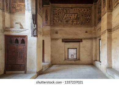Cairo, Egypt - December 16 2018: Stone wall with wooden window (Mashrabiya) at ottoman era historic Beit El Set Waseela building (Waseela Hanem House), Old Cairo