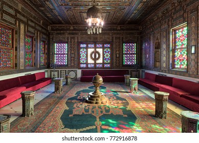 Cairo, Egypt - December 2 2017: Manial Palace of Prince Mohammed Ali. Syrian Hall with ornate wooden wall and ceiling, windows with colored stained glass and Ottoman Empire logo, old ornate chandelier