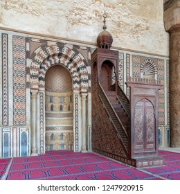 Cairo, Egypt - December 2 2018:  Colorful decorated marble wall with engraved Mihrab (niche) and wooden Minbar (Platform) at the Mosque of Al Nasir Mohammad Ibn Qalawun, Citadel of Cairo