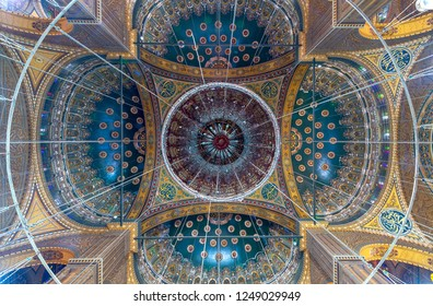 Cairo, Egypt - December 2 2018: Ceiling of the great Mosque of Muhammad Ali Pasha (Alabaster Mosque) decorated with golden and blue floral patterns, situated in the Citadel of Cairo