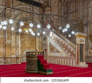 Cairo, Egypt - December 2 2018: Decorated alabaster (marble) wall with engraved niche (Mihrab) and Platform (Minbar) at the great Mosque of Muhammad Ali Pasha (Alabaster Mosque), Citadel of Cairo
