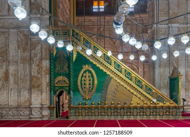 Cairo, Egypt - December 2 2018: Decorated alabaster (marble) wall with green wooden platform (Minbar) at the great Mosque of Muhammad Ali Pasha (Alabaster Mosque), situated in the Citadel of Cairo