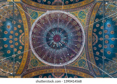 Cairo, Egypt- December 2 2018: Ceiling of the great Mosque of Muhammad Ali Pasha (Alabaster Mosque) decorated with golden and blue floral patterns, situated in the Citadel of Cairo