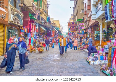 CAIRO, EGYPT - DECEMBER 20, 2017: Two arab women make shopping in one of numerous shopping streets in Khan El-Khalili Market, on December 20 in Cairo.